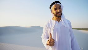 Arab male sales representative looks at camera and tells informa Stock Photos