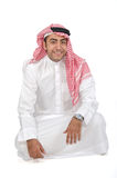 Arab man. Sitting on the floor on white background Royalty Free Stock Photos