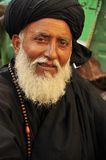Arab man with black  turban. Arab man with black turban and white beard, in Pakistan Royalty Free Stock Images