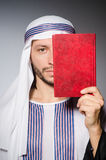 Arab man with book Stock Photos