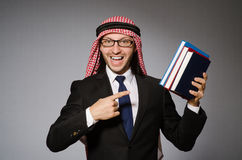 Arab man with book Royalty Free Stock Photos