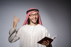Arab man with book Royalty Free Stock Image