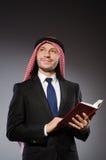 Arab man with book Stock Photos