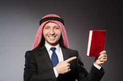Arab man with book. In diversity concept Royalty Free Stock Image