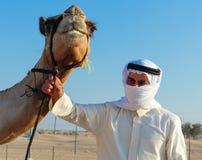 Arab man and camel Stock Photo