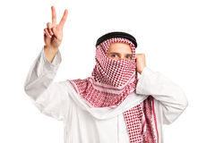 Arab man with covered face gesturing victory Stock Photos
