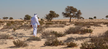 Arab man in desert Royalty Free Stock Photography