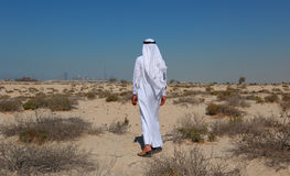 Arab man in desert Royalty Free Stock Image
