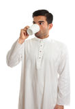 Arab man drinking coffee. An arab middle eastern man drinking coffee.   Arabica coffee is indigenous to the mountains of Yemen.  The Arab innovation in Yemen of Royalty Free Stock Photography