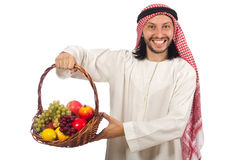 Arab man with fruits isolated on white Stock Images