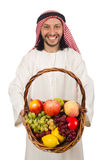 Arab man with fruits isolated on white Stock Photos