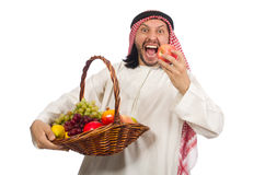 Arab man with fruits isolated on white Royalty Free Stock Photography