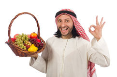 The arab man with fruits isolated on white Royalty Free Stock Images