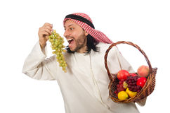 The arab man with fruits isolated on white Royalty Free Stock Photos