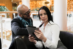 Arab man and girl looking photos on digital tablet Royalty Free Stock Photos