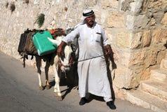 Arab Man and His Donkey Royalty Free Stock Photography