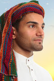 Arab man looks out expectantly. An arab middle eastern man looks out expectantly, earnestly.  He is wearing traditional clothing Royalty Free Stock Images