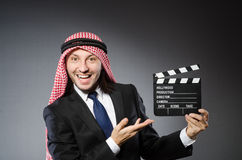 Arab man with movie clapper Stock Photos
