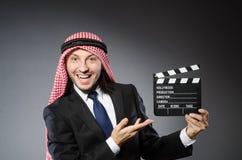 Arab man with movie clapper Stock Photos