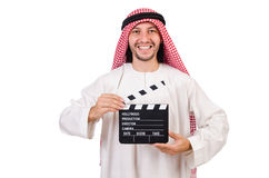 Arab man with movie clapper Royalty Free Stock Photography