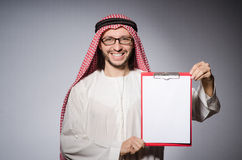 Arab man with paper. Binder Royalty Free Stock Photo