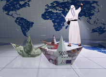 The arab man and paper dollar euro boats Stock Images