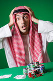 Arab man playing in the casino Royalty Free Stock Photo