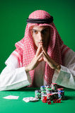 Arab man playing in the casino Stock Image