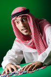 Arab man playing in the casino Stock Images