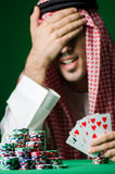 Arab man playing in the casino Royalty Free Stock Photography