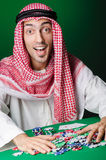 The arab man playing in the casino Stock Images