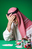 The arab man playing in the casino Royalty Free Stock Photos