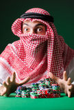 The arab man playing in the casino Stock Photography