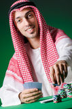 The arab man playing in the casino Stock Image