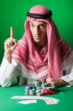 The arab man playing in the casino Royalty Free Stock Photography