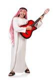 Arab man playing guitar Royalty Free Stock Image