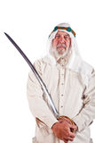 Arab Man Posing with a Sword. Older Arab man posing with an antique sword, isolated on white Royalty Free Stock Photos