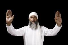Arab Man Praying. Stock image of Arab man praying over black background Royalty Free Stock Image