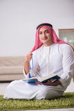 The arab man praying at home Royalty Free Stock Photos