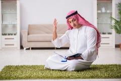 The arab man praying at home Stock Photos
