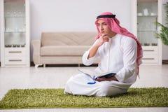 The arab man praying at home Royalty Free Stock Photography