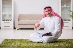 The arab man praying at home. Arab man praying at home Stock Photos