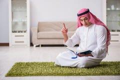 The arab man praying at home. Arab man praying at home Royalty Free Stock Images