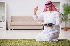 The arab man praying at home. Arab man praying at home Stock Photography
