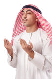 Arab man praying on white Stock Photography