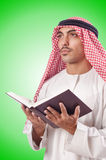 Arab man praying on white Stock Images