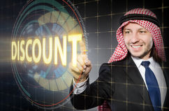The arab man pressing buttons in sale concept Stock Images