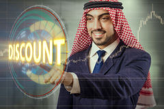 The arab man pressing buttons in sale concept Stock Photo