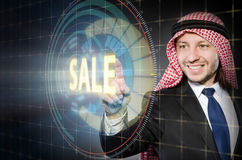 The arab man pressing buttons in sale concept Royalty Free Stock Images