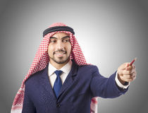 Arab man pressing virtual buttons Stock Images